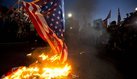 Burning the flag: a sign of civil unrest