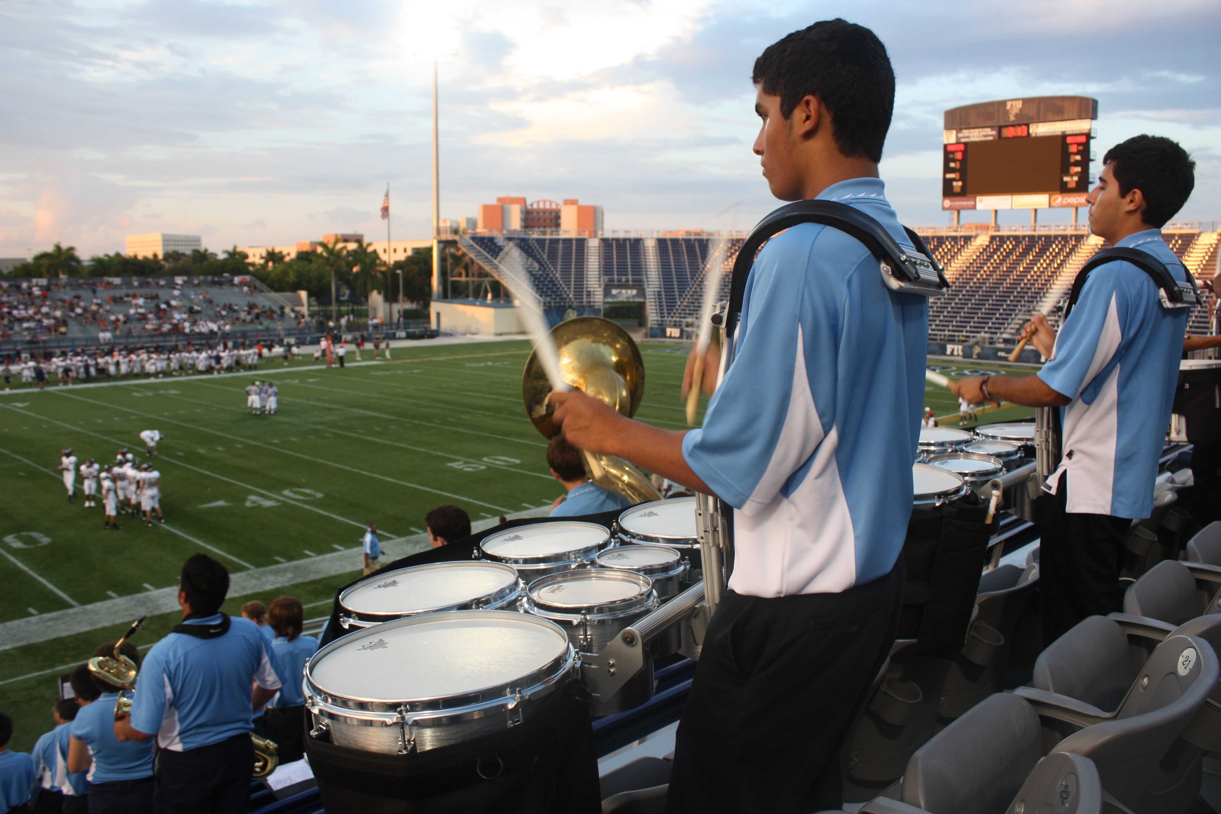 """Junior Alexander Perez plays alongside fellow drum-liners at a football game. Perez always enjoys watching the scene from up above. """"High school seems so great while standing up in the bleachers,"""" Perez said."""