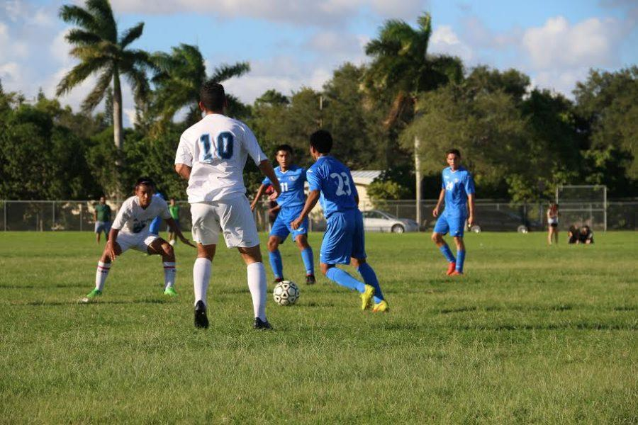 Senior forward Mathew Posada attempts to win back the possession after the South Dade defender stifles a Palmetto scoring opportunity.