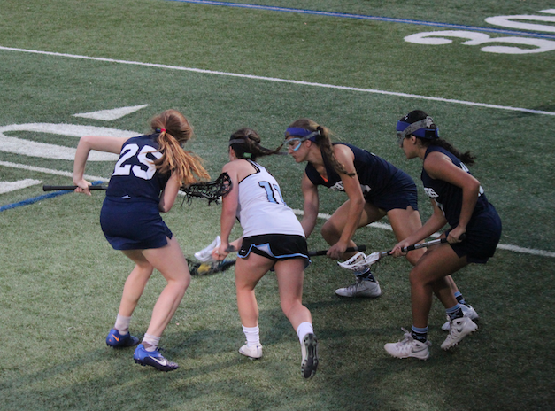 """Palmetto girls were destined to get the ball from this Ransom player. With the audience on their feet, the game looks good. """"When you gain possession you hear them cheering for you and it makes you want to run faster,"""" Michelle Monjarrez (10)"""