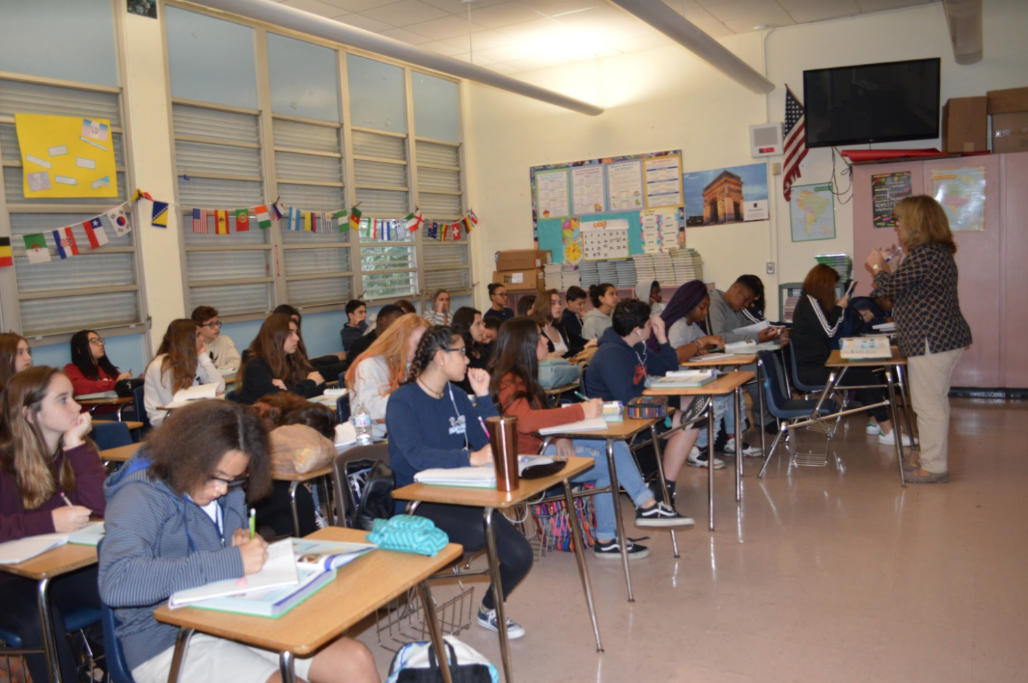 Ms. Sonia Nuñez's speaks to her overcrowded third period, French 2 class