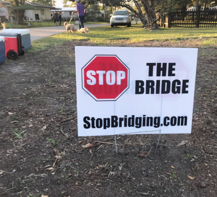 One of the many signs displayed around Palmetto Bay protesting the building of the bridge   (sign depicted here was placed on 87th Ave.)
