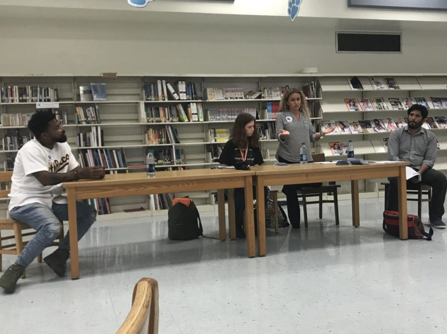 (from left to right) Phillip Agnew, Nicole Markus, Monica Espitia and Juan Cuba lead a discussion about how to protest effectively at a meeting on March 7 after school in the media center. Students have organized a walkout for March 14 at 10:00 a.m.
