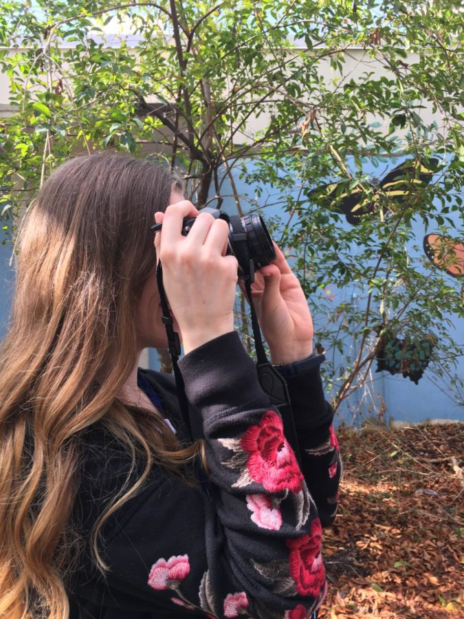 Brooke Brown adjusts her settings before taking a photo.