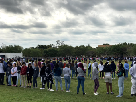 Palmetto students participate in a school-sanctioned walkout on the field on March 14 in remembrance of the Parkland shooting victims. The walkout took place a month after the shooting and included a moment of silence that lasted 17 minutes, one minute for each victim. Photo by Allessandra Inzinna.