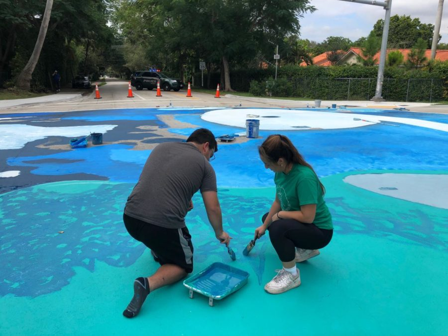 Students from Westminster paint the number nine of the corner of 67th avenue and 112th street.