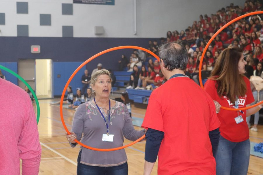 Staff and students participate in the human ring toss.