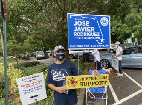 A volunteer campaigns for Jose Javier Rodriguez
