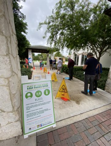 Floridians wait in lines at the Pinecrest Library to vote early.