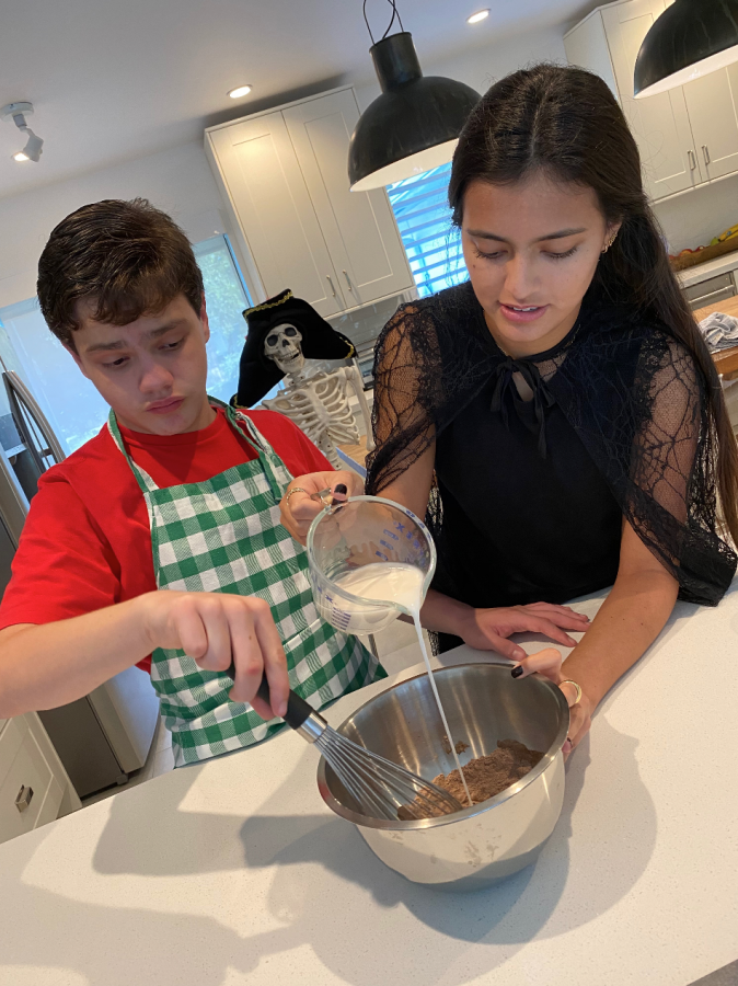 Sofia Palacios and her brother, Gabriel, demonstrate how to bake a Halloween treat for their class (photo courtesy of Palacios).