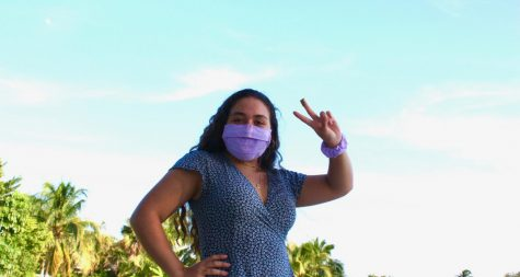 Senior Miriam Gomez wears her hand-made, lavender gingham face mask.