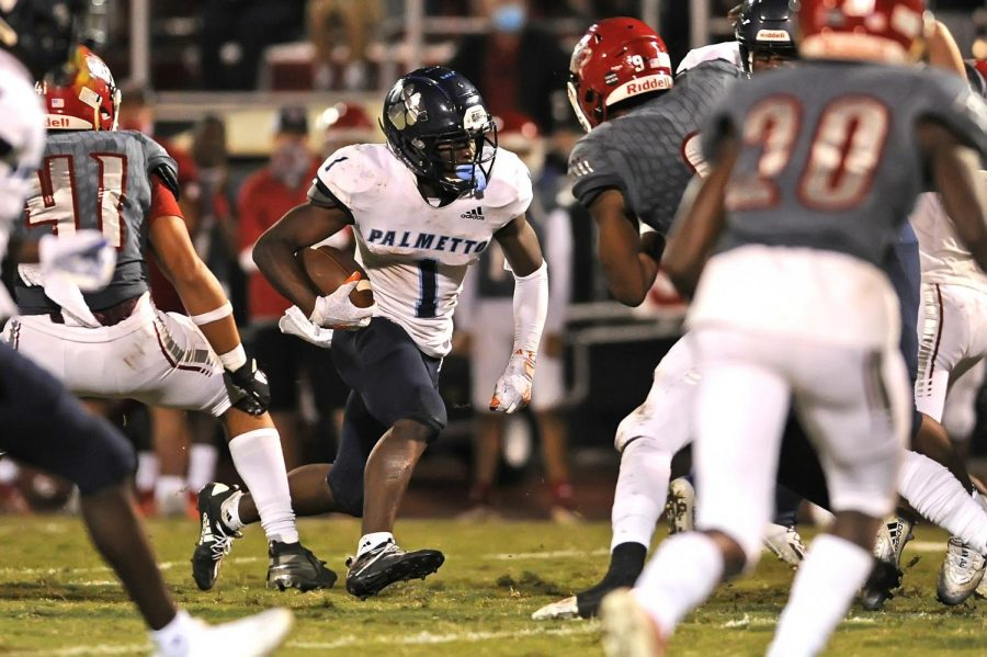 Palmetto wide receiver Brashard Smith runs through the defense en route to a 10-7 victory against Vero Beach. (Photo courtesy of Matthew Lewis/ImageReflex)