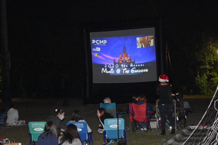 The event was broadcast to the audience via an outdoor projection screen.