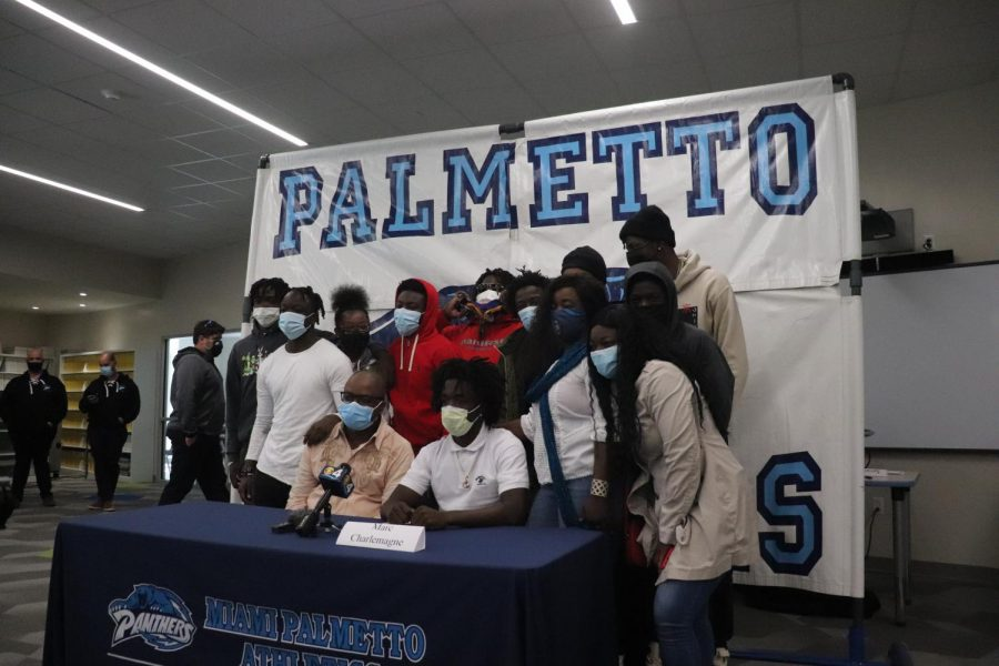 Charlemagne poses with his family after announcing his commitment.