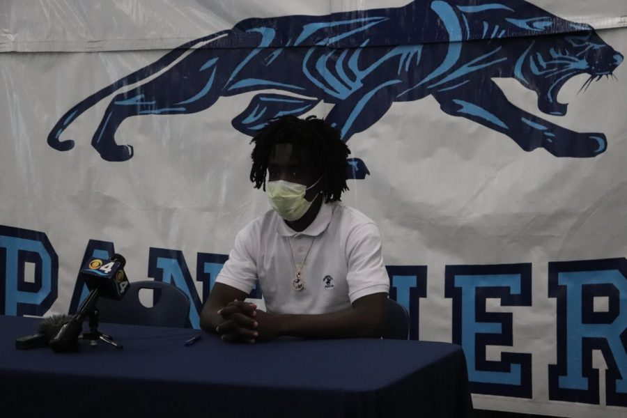 Charlemagne sits and reflects after officially signing to Glenville State.