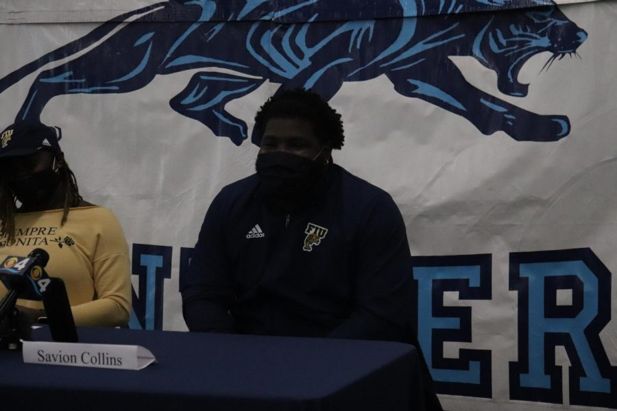 Collins beams as he shows off his FIU gear right after officially committing.
