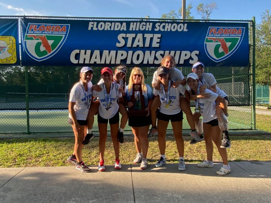 Mrs.Gibson and the girls tennis team smiling with their states trophy.  Photo courtesy of Mia Sorrentino
