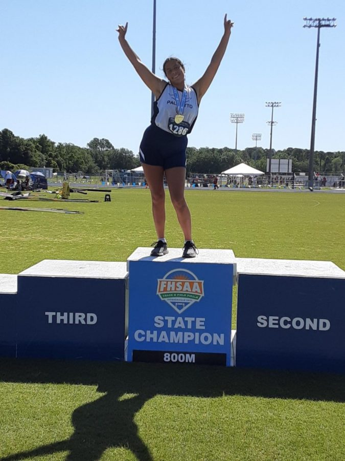 Sofia celebrates her success atop the state champion block.