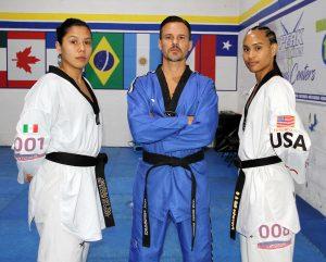 Briseida Acosta, Coach Juan Moreno, and Paige McPherson at the Peak Performance Miami training center.