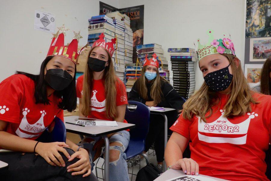 Four seniors show off their crowns during their AP Art History class.