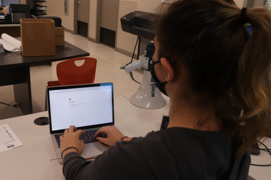 Palmetto Senior and Office Aid Josie Blohm struggles to connect to the school wifi.